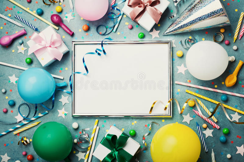 Party or birthday background. Silver frame with colorful balloon, gift box, carnival cap, confetti, candy and streamer. Party or birthday background. Silver royalty free stock images