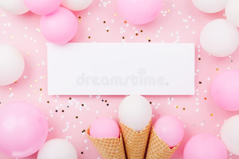 Party or birthday mockup with paper card, pastel balloons and confetti on pink table top view. Flat lay composition. royalty free stock photos