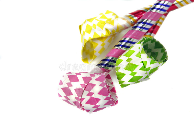 Party Blowers. Three party blowers or noisemakers on a white background royalty free stock photography