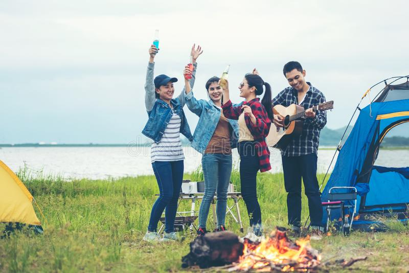 Party Camping.  Group asian family and friends travel enjoy party and roasted sausages relax in vacations. Campfire at touristic c stock photos