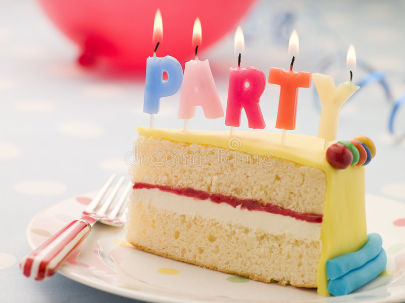 Party Candles on a Slice of Birthday Cake. On a table stock image