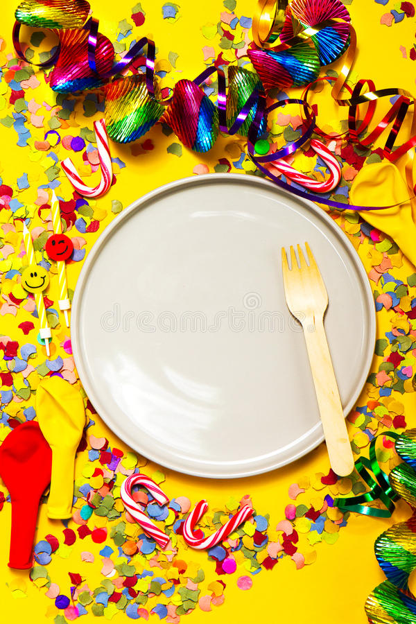 Party or Carnival background or Party concept with fun articles. And party accessories, empty plate above. Top view stock photography