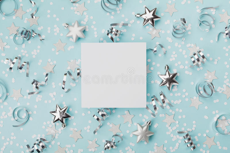 Party carnival christmas mockup decorated confett and silver star on turquoise background top view. Flat lay. Holiday invitation. Party carnival christmas royalty free stock image