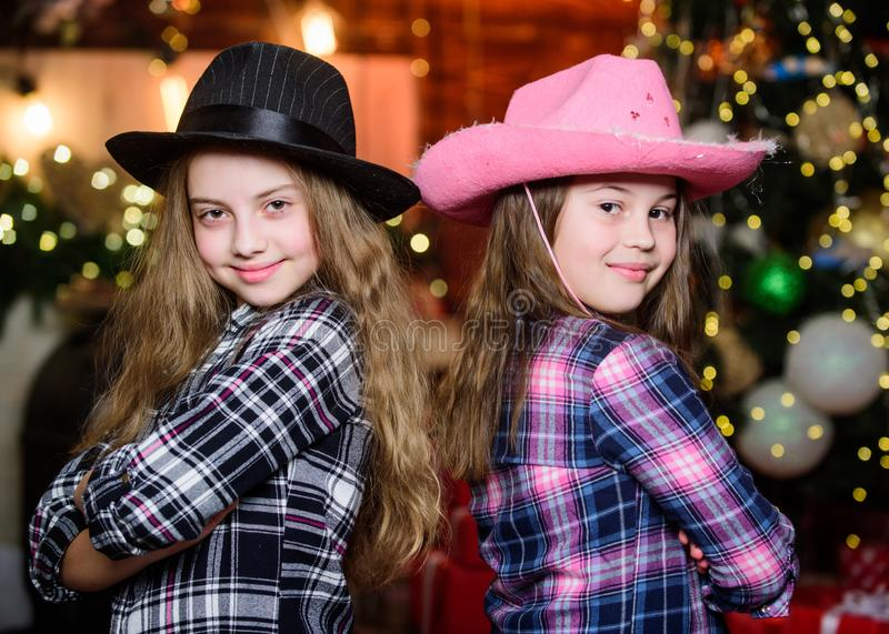 Party is on. Christmas party concept. Girls sisters carnival hats costumes new year party. Kids friends celebrate winter stock photography