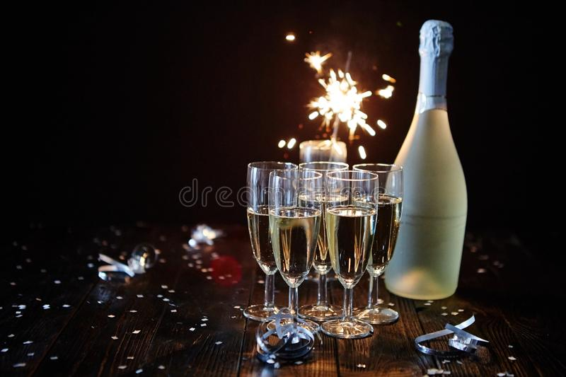 Party composition image. Glasses filled with champagne placed on black table royalty free stock photos