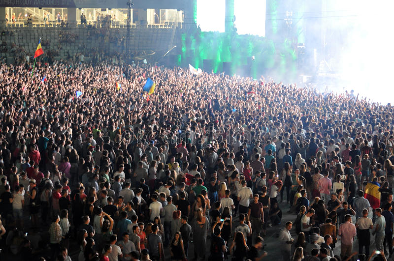 Party crowd dancing at concert. CLUJ NAPOCA, ROMANIA – AUGUST 2, 2015: Crowd of partying people enjoy a David Guetta live concert at the Untold Festival stock photos
