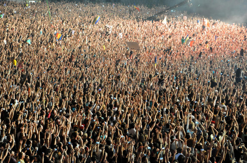 Party crowd dancing at concert. CLUJ NAPOCA, ROMANIA – AUGUST 2, 2015: Crowd of partying people enjoy a David Guetta live concert at the Untold Festival royalty free stock images