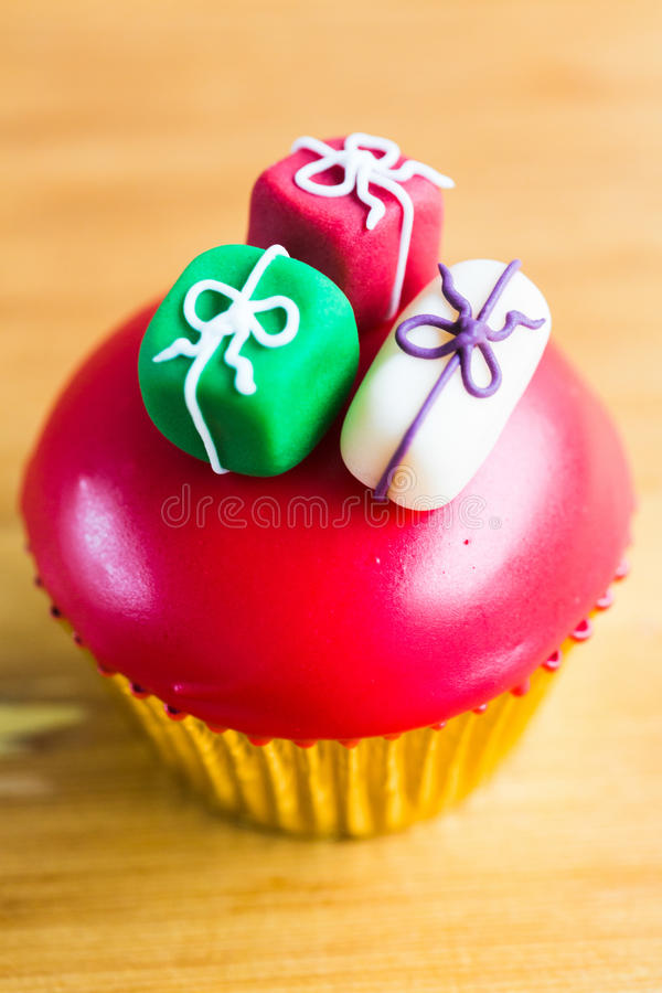 Party cupcake decorated with gifts royalty free stock image