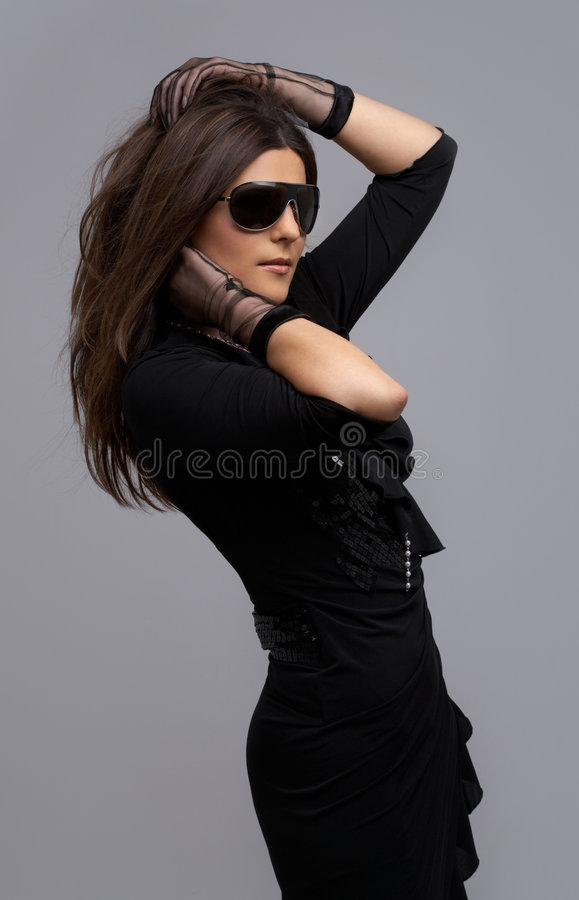Party dancer in black dress. Over grey royalty free stock photos