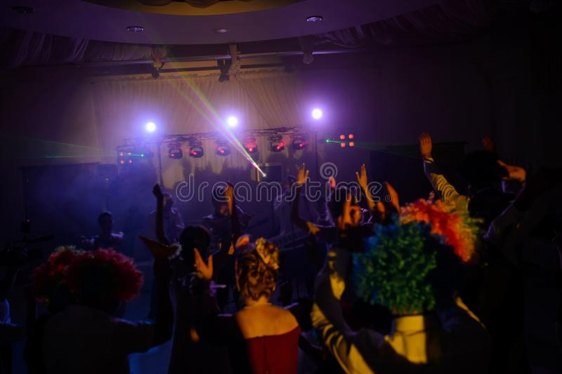 The party, dancing on the floor. Colorful lights, hands up stock images