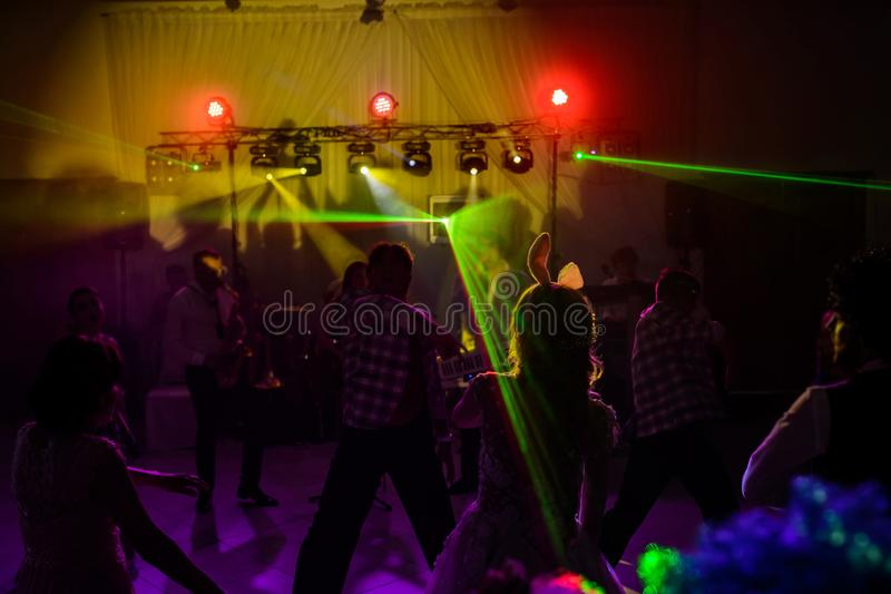 The party, dancing on the floor. Colorful lights, hands up stock photography