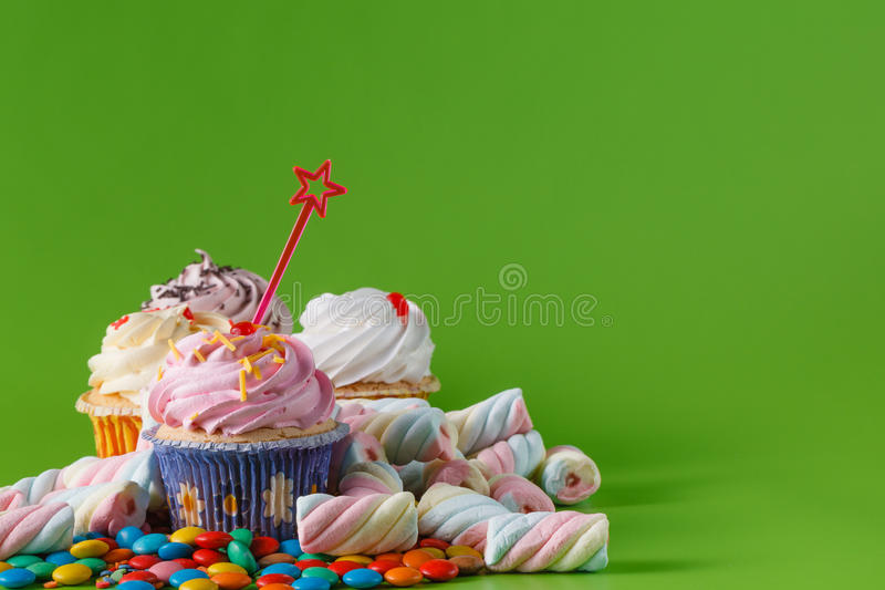 Party decoration concept. Fun party sweets invitation card. Cupcake and marshmallow stock photos