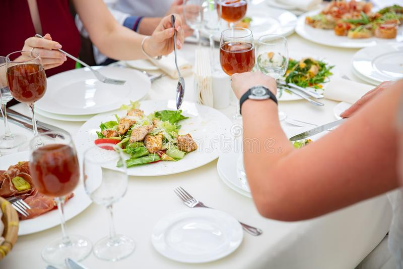 Party dinner table, celebrating with friends of family served at home or in a restaurant. royalty free stock photo
