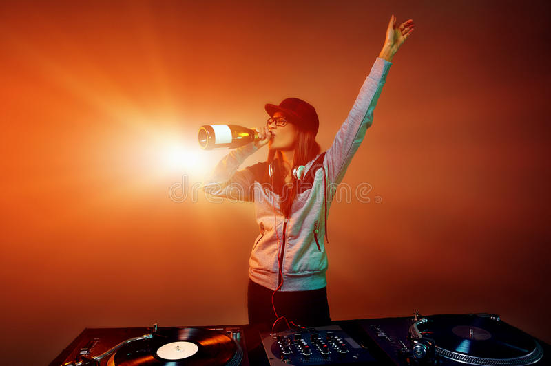 Party dj. Nightclub dj party with bubbly champagne and vinyl music playing royalty free stock photos