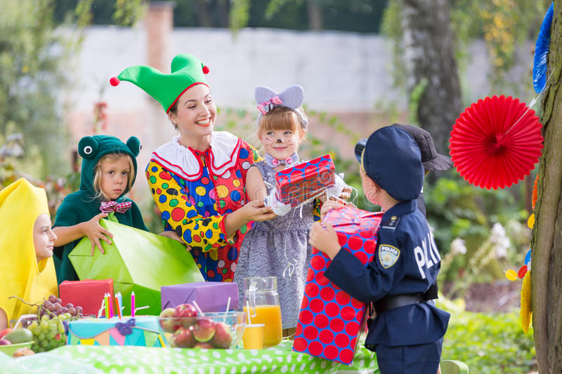 Party entertainer with children stock photos