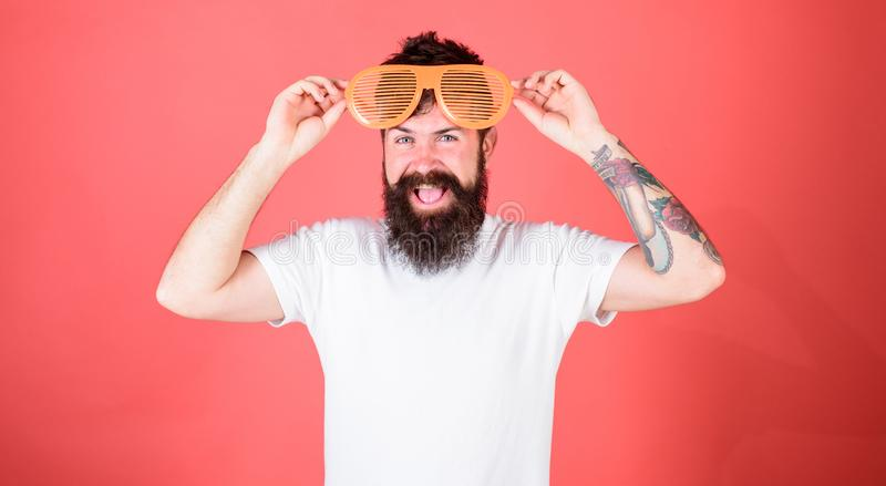 Party festive accessory. Sunglasses party attribute and stylish accessory. Party detail accessory concept. Man bearded. Hipster wears giant louvered sunglasses stock photo