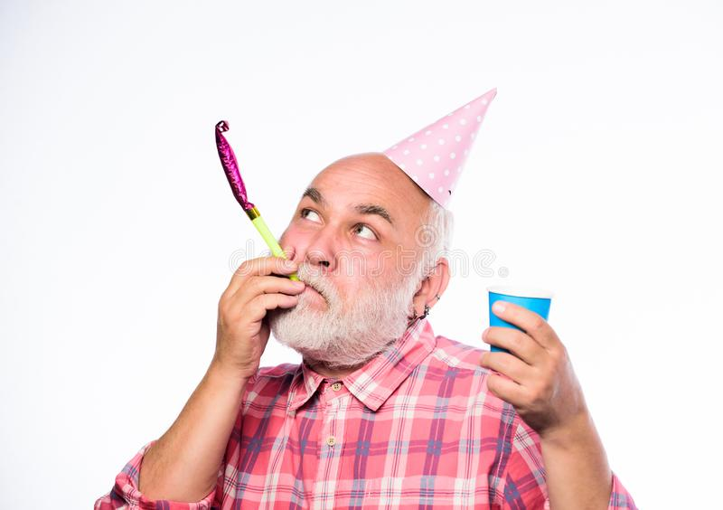 Party fun. happy birthday. corporate party. anniversary holiday celebration. man hold party cone hat and whistle. happy. Man with beard. retirement party stock photo