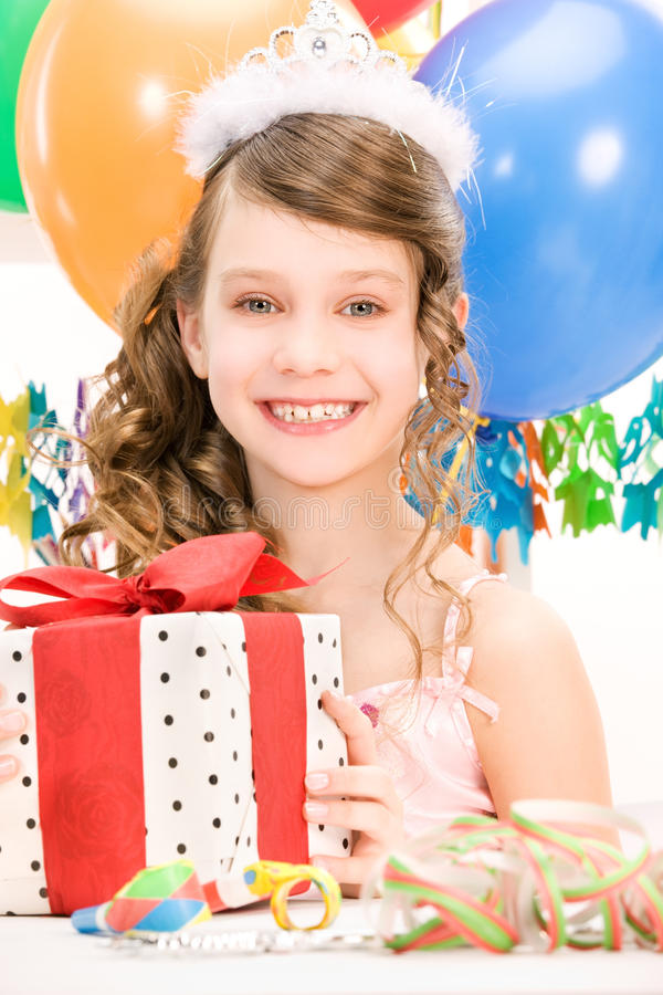 Party girl with balloons and gift box. Happy party girl with balloons and gift box stock photography