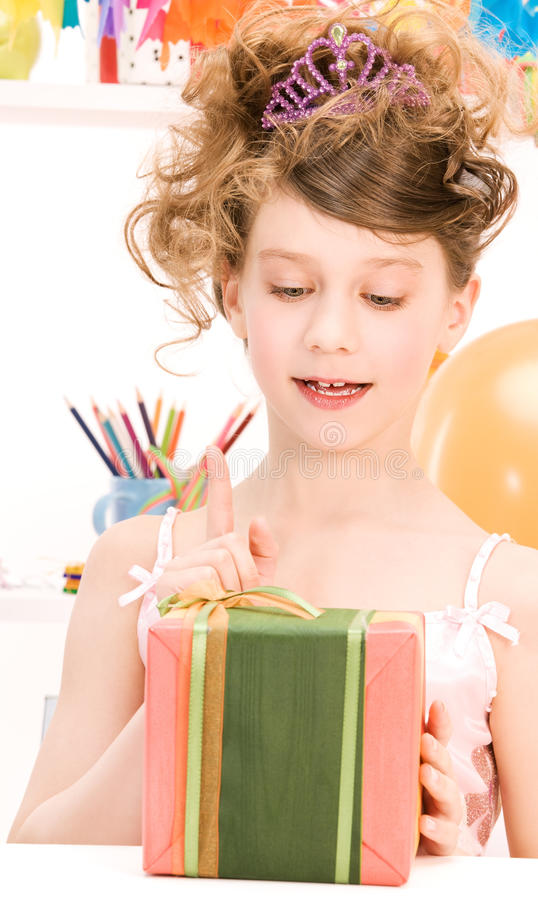 Party girl with balloons and gift box. Happy party girl with balloons and gift box royalty free stock photography
