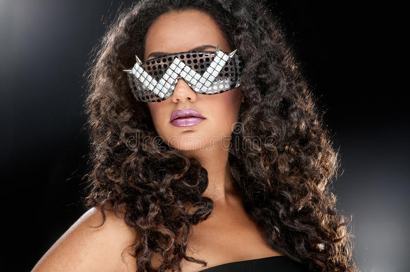 Party girl in club glasses royalty free stock photography