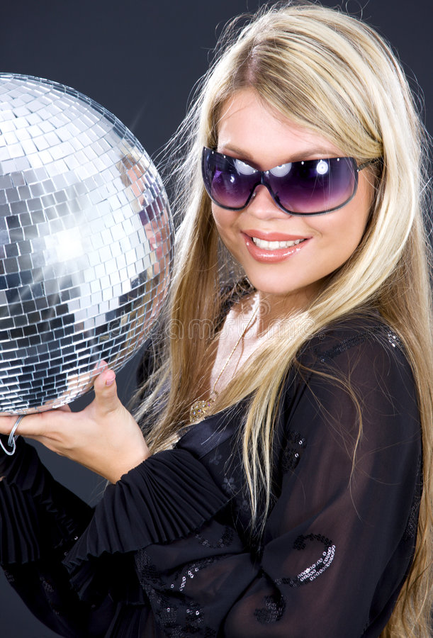 Party girl with disco ball. Portrait of party girl with disco ball royalty free stock photo
