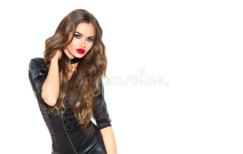 Party girl portrait. Halloween Witch with bright make-up and long hair. Beautiful young woman in sexy black leather dress. Party girl portrait. Halloween Witch stock photography
