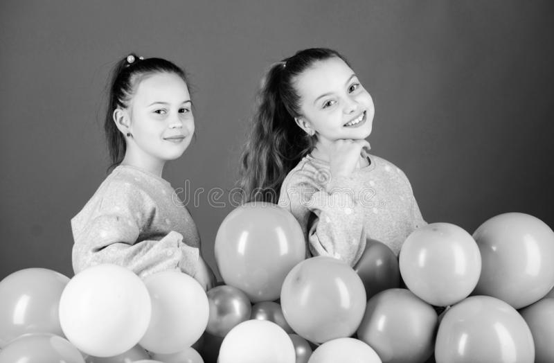 Party is on. Happy children playing with air balloons. Using balloons for birthday celebration. Little girls having fun. With colorful balloons. The balloons stock image