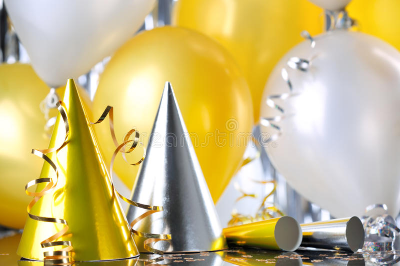 Party hats and balloons royalty free stock image