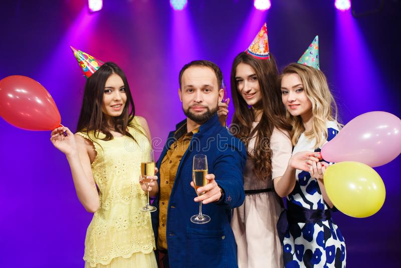 Party, holidays, celebration, nightlife and people concept - smiling friends with glasses of champagne in club royalty free stock images