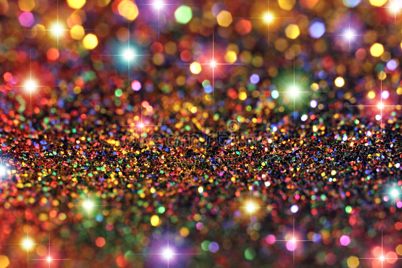 Party Lights Glitter and Stars Background. Multicolored glitter with stars and bokeh