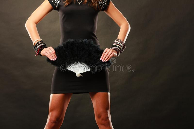 Woman evening dress with black fan in hand stock photography