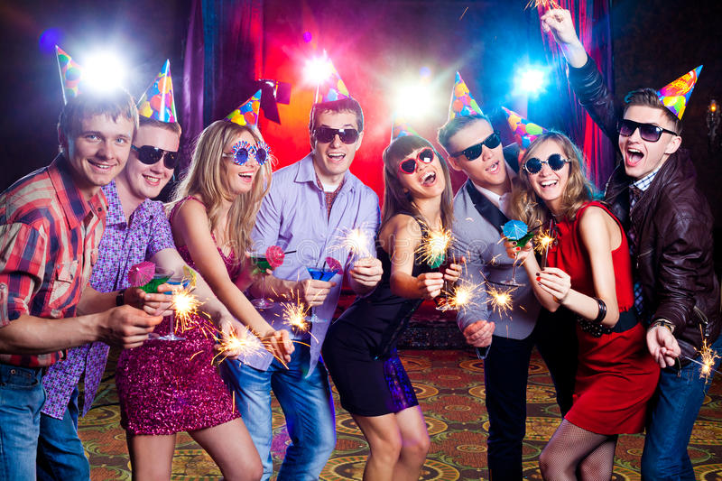 Party at nightclub. Cheerful young company celebrates in a nightclub royalty free stock photos