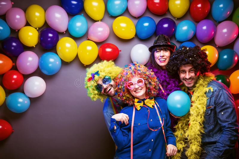 Party People celebrating carnival or New Year in party club stock images