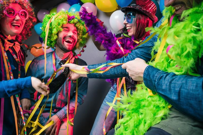 Party People celebrating carnival or New Year in party club stock photo