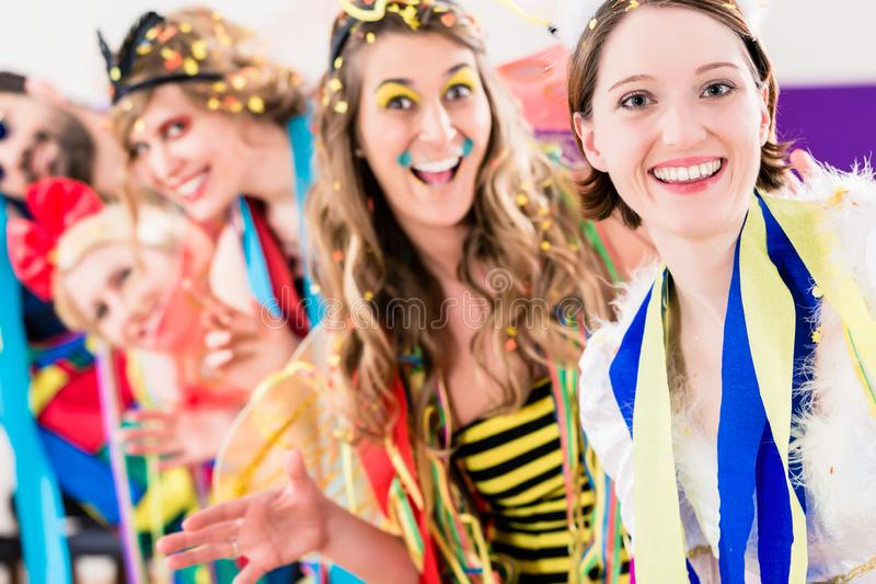 Party people celebrating carnival or new years eve royalty free stock photo