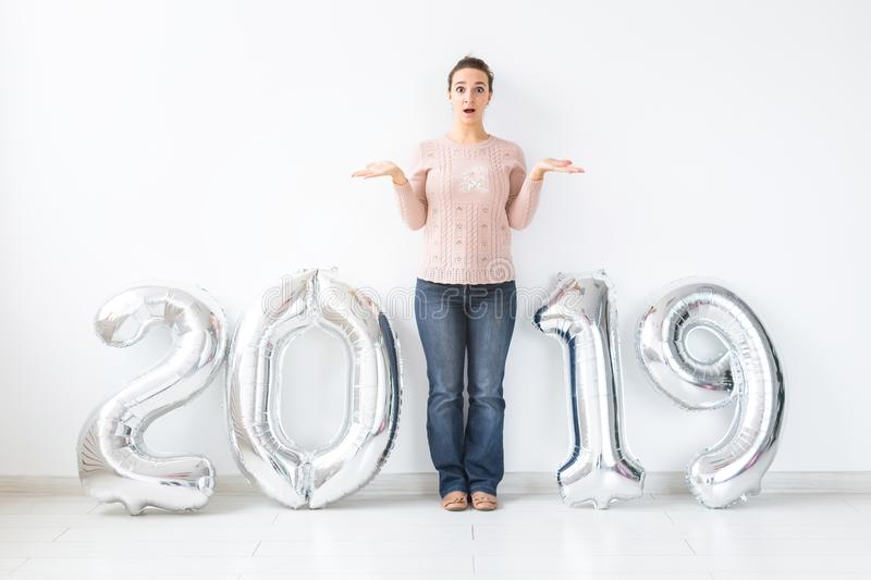 Party, people and new year holidays concept - Surprised young woman celebrating new years eve 2019 stock images