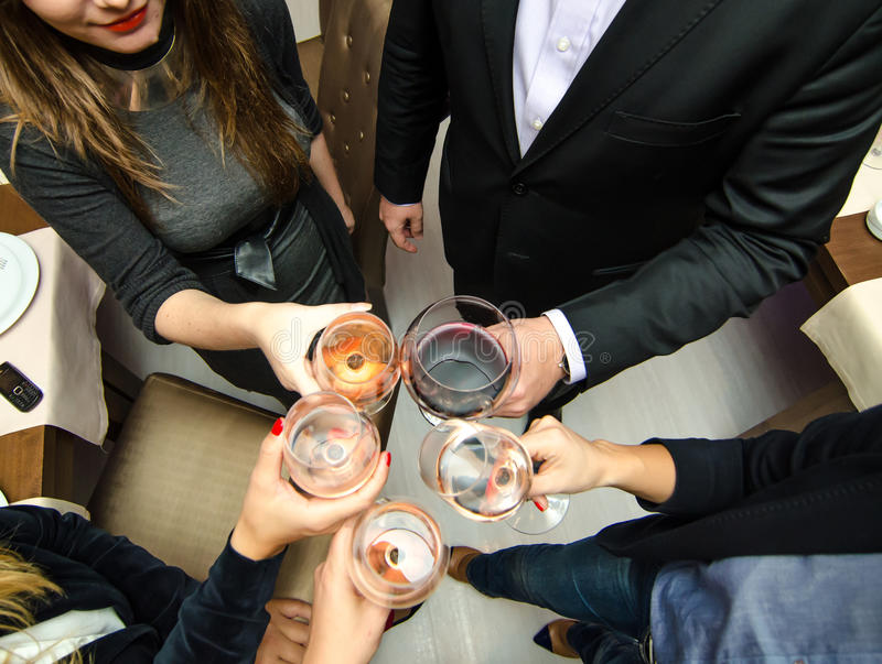Party people. People toasting wine at a party royalty free stock photo