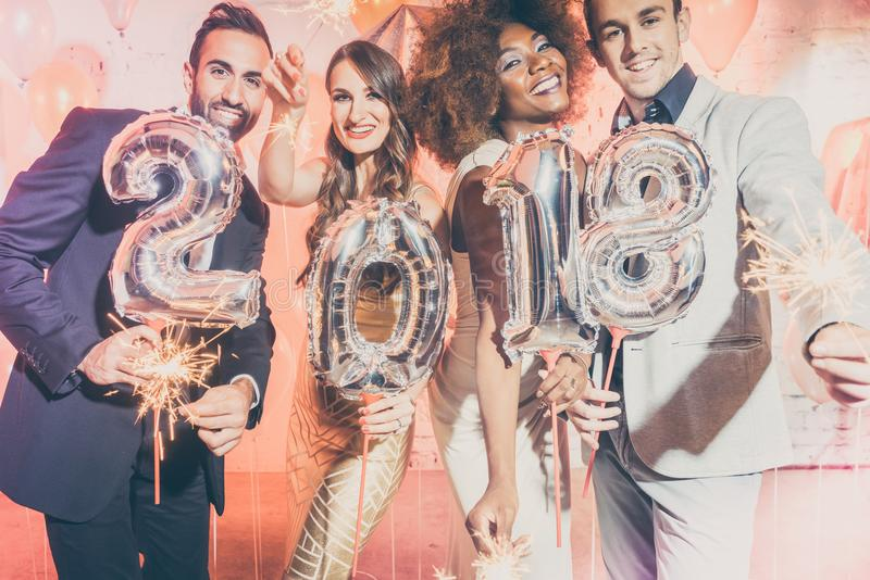 Party people women and men celebrating new years eve 2018 stock photo