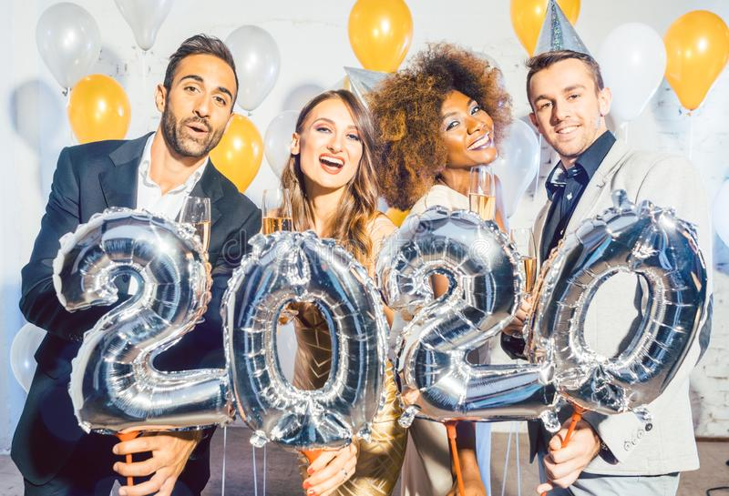 Party people women and men celebrating new years eve 2020 royalty free stock image