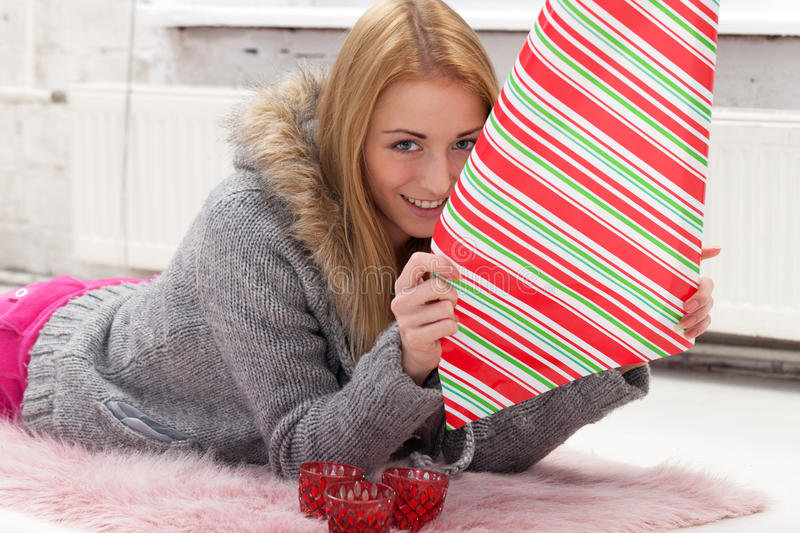Party preparations. Girl with decoration paper preparing gifts stock photos