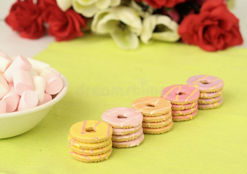 Party rings cookies. Colourful crunchy iced ring biscuits royalty free stock photos
