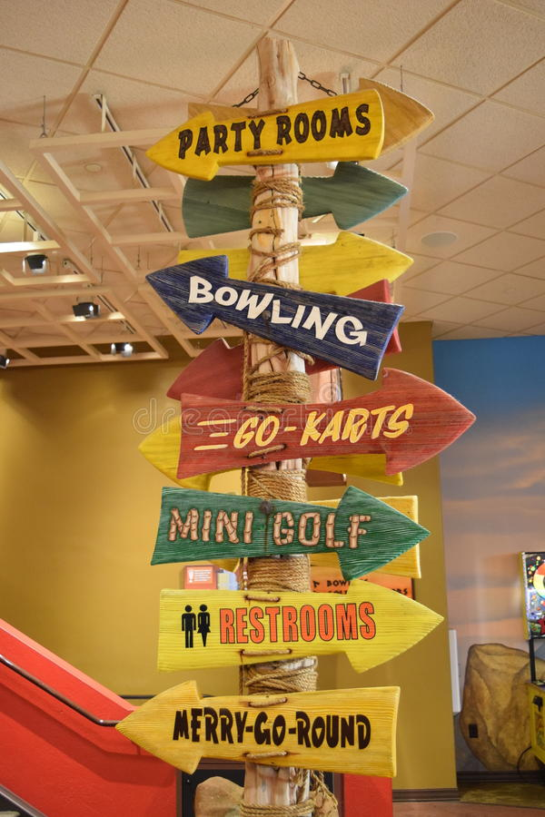 Party Rooms Bowling Go Karts Mini Golf Restrooms Merry-Go-Round Arrow Signs royalty free stock photos