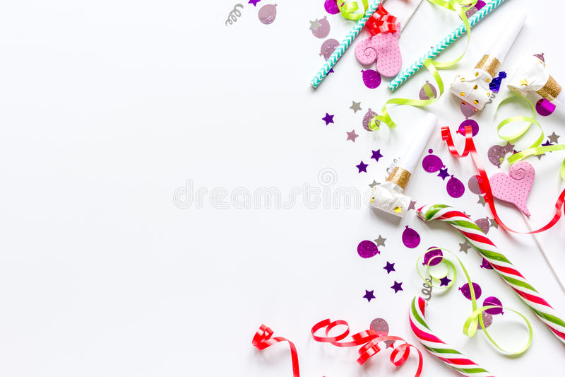 Party set with lollipop and confetti on white background top view mock up. Colored party set with sugar lollipop and confetti on white table background top view royalty free stock photos