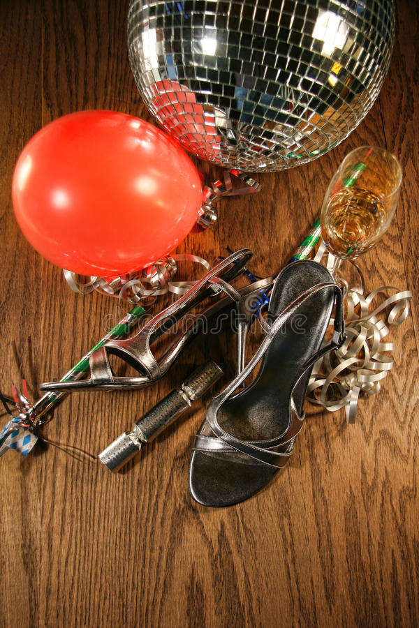 Party shoes on floor with champagne glass. Party shoes on wood floor with champagne glass stock images
