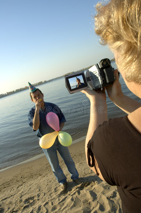 Party shooting on camcorder stock image