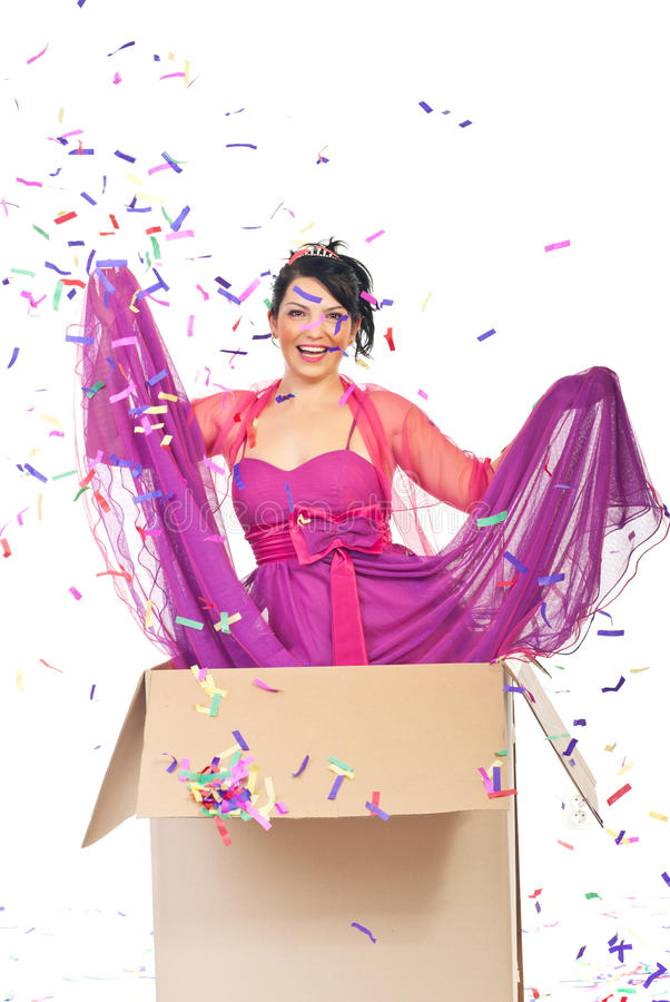 Party surprise. Beautiful laughing woman out of the box and make a surprise at party royalty free stock photos