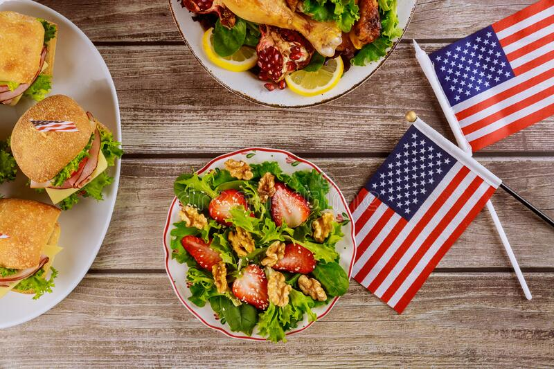 Party table for celebrating american holiday Independence, President, Memorial Day. Party table with salad, chicken and sandwiches for celebrating american royalty free stock photos