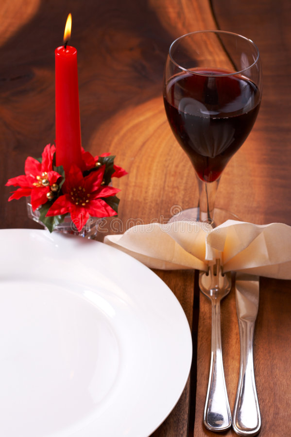 Party table setting. With a glass of wine and a candle stock images
