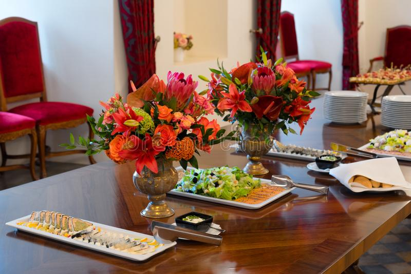 Party table setting decorated with flower bouquets, catering royalty free stock photo