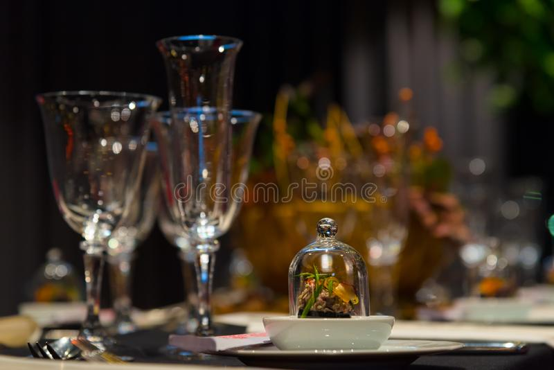 Party table setting, wine and champagne glasses, gourmet snack, restaurant interior, christmas dinner royalty free stock photography